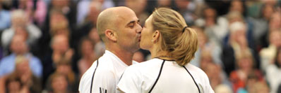 Andre Agassi and Steffi Graf kiss on court